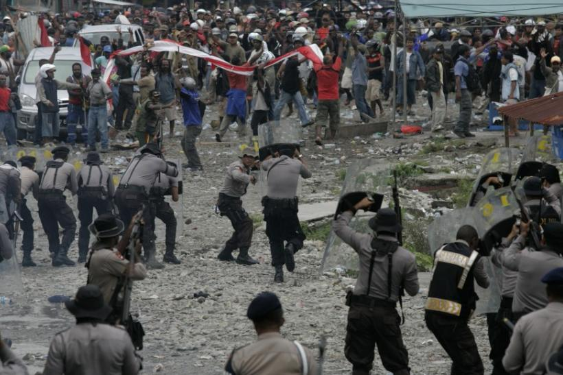Striking Freeport miners clash with police during the strike