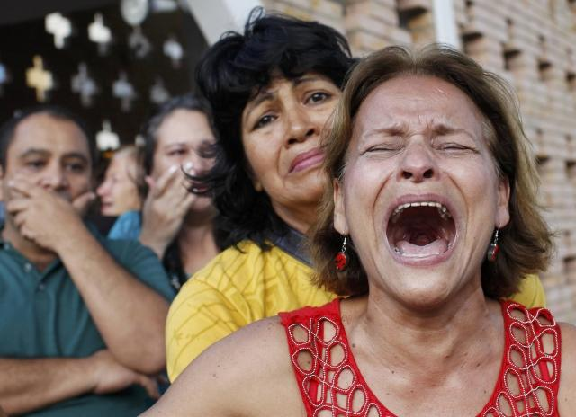 Supporters of Chavez mourn his death