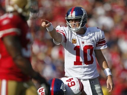 NFC East Quarterback Rankings: How Tony Romo, Mike Vick, RG3 And Eli Manning Fared Through Week 4