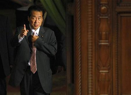 Japan`s Deputy Prime Minister Naoto Kan arrives at a lower house plenary session at Parliament in Tokyo