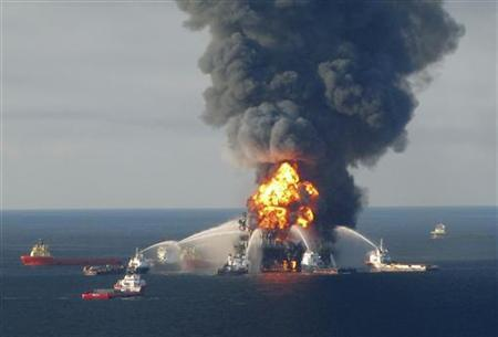 Fire boat response crews battle the blazing remnants of the off shore oil rig Deepwater Horizon, off Louisiana