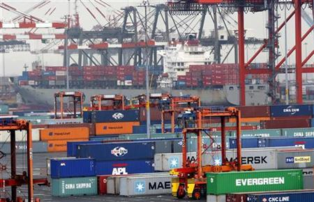 Shipping containers are seen at the Port Newark Container Terminal near New York City as government reported lowest trade gap since 1999