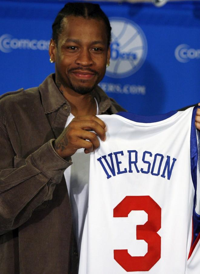 76ers guard Iverson holds up his jersey during a news conference announcing his return to the 76ers in Philadelphia Pennsylvania