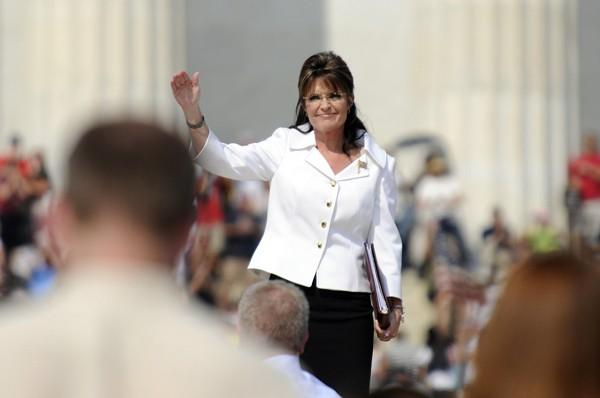 Palin greets the crowd as she stands on the steps in front of the Lincoln Memorial to address supporters at Beck's Restoring Honor rally on the National Mall in Washington