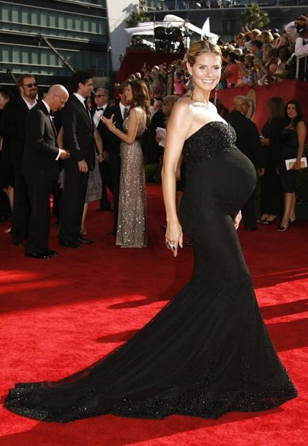 "Pregnant nominee Klum of ""Project Runway"" arrives on the red carpet at the right at the 61st annual Primetime Emmy Awards"