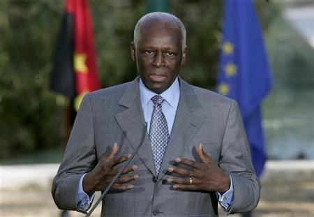 Angola's President Jose Eduardo dos Santos talks to journalists after a signature agreement ceremony held at Sao Bento Palace in Lisbon, Portugal