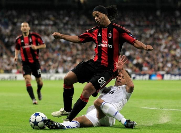 AC Milan's Ronaldinho is challenged by Real Madrid's Carvalho during their Champions League Group G soccer match in Madrid