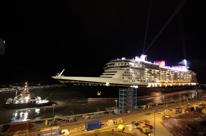 New cruise ship Disney Dream passes floodgate to the Ems river as it leaves Meyer shipjard in Papenburg