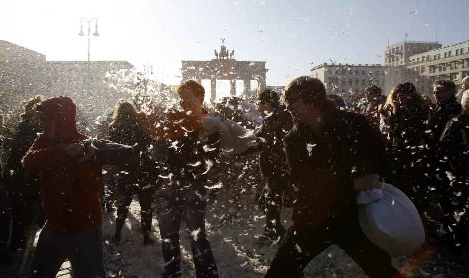 People attend flashmob pillow fight at Brandenburger Tor gate in Berlin