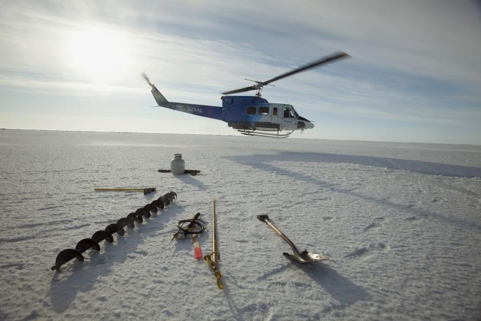 A helicopter drops off supplies at a remote warming station near the 2011 Applied Physics Laboratory Ice Station north of Prudhoe Bay