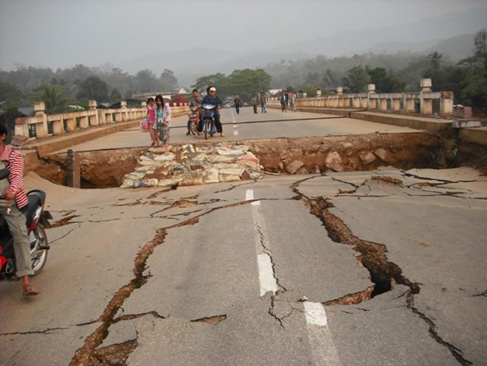 An earthquake damaged road and bridge are seen in Tarlay