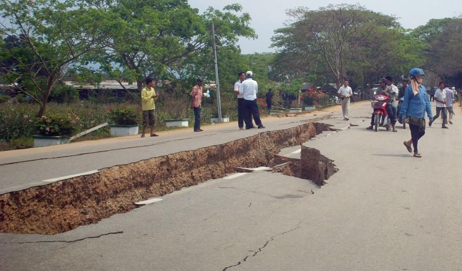 An earthquake damaged road is seen in Tarlay