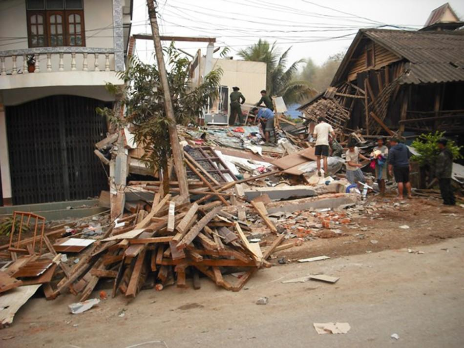 Earthquake damaged buildings are seen in Tarlay