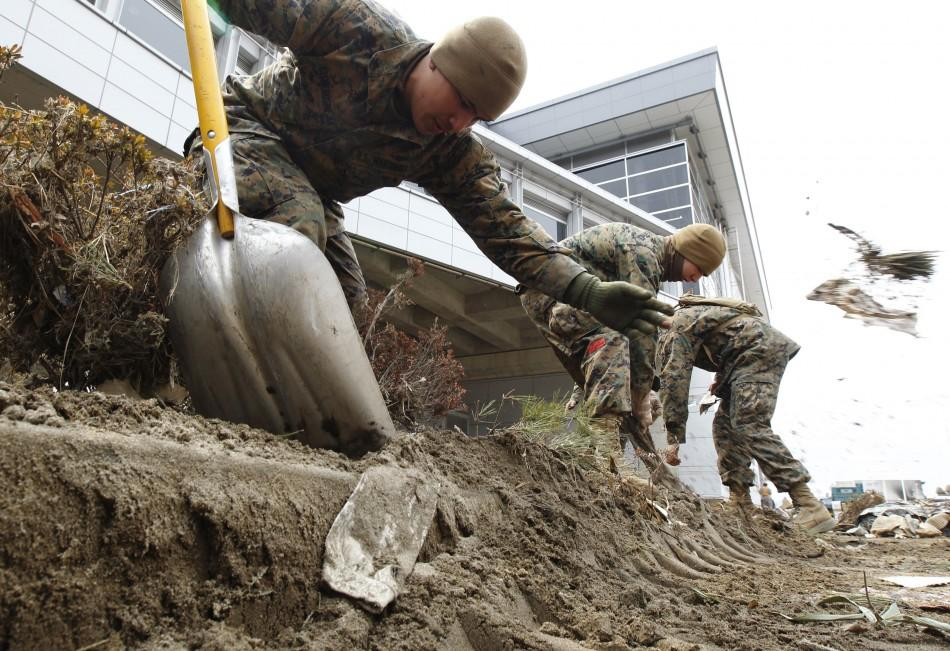 U.S. marines based in Japan start to clear rubble after the earthquake and tsunami in Sendai, Miyagi Prefecture