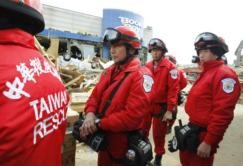 Taiwanese rescue officers prepare for their rescue operation at a village destroyed by an earthquake and tsunami in Ofunato, northeast Japan
