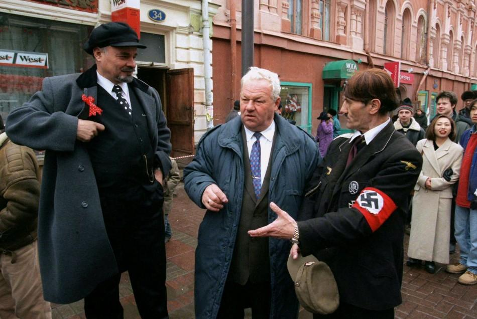 Look alikes of Vladimir Lenin (L), Boris Yeltsin (C) and Adolf Hitler gather on Arbat street in Mosc..