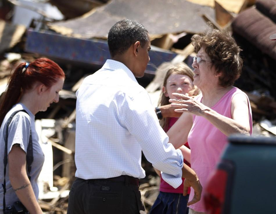 President Barack Obama hugs a woman as he inspects tornado damage