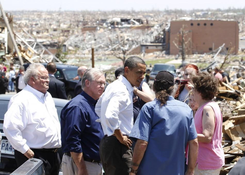 President Barack Obama speaks to resident as he inspects tornado damag