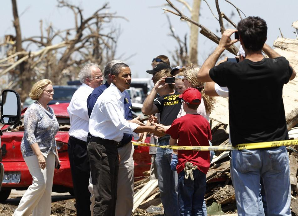 U.S. President Barack Obama greets residents affected by the tornado damage in Joplin