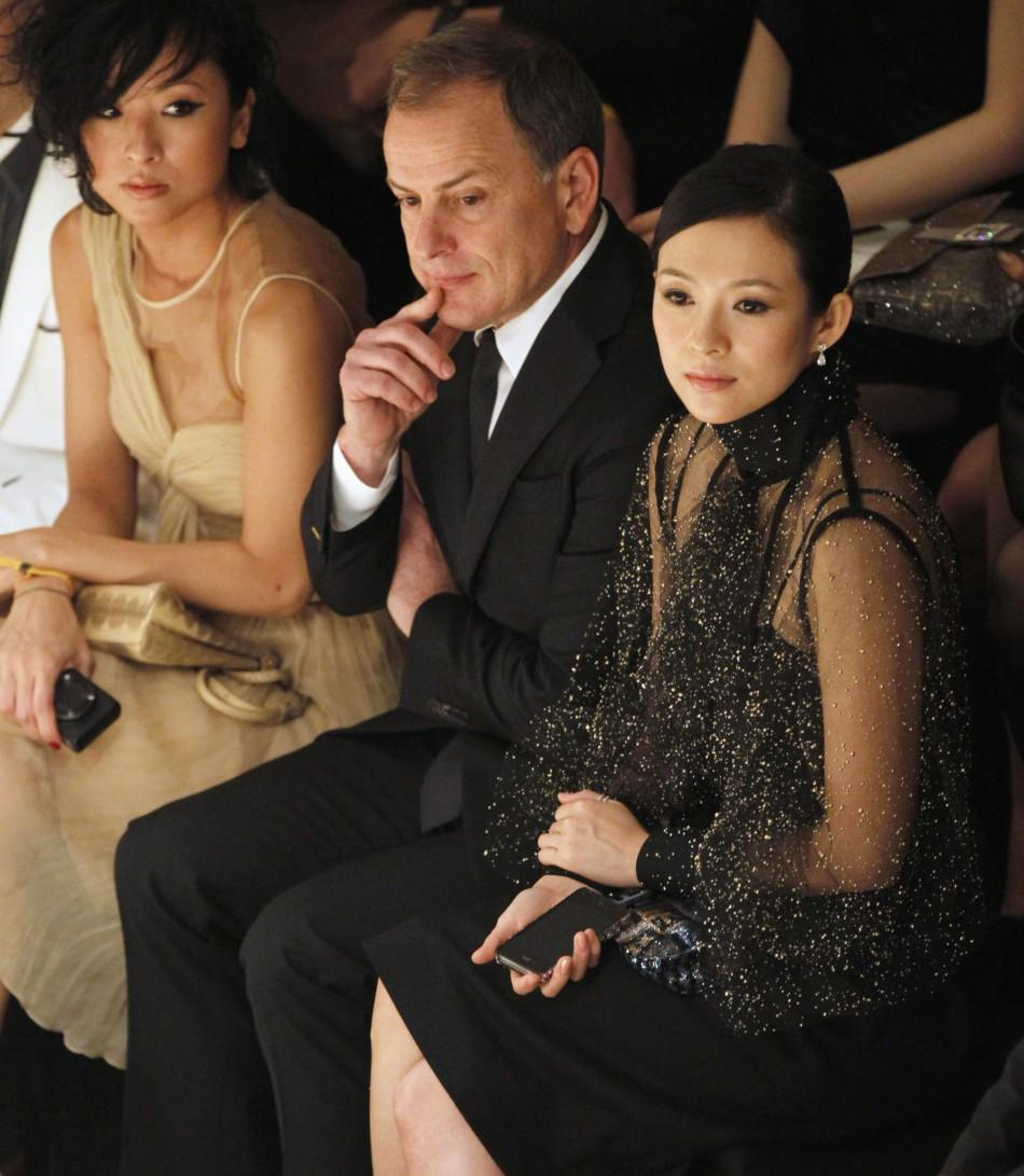 3e08b761a656 ... Ziyi and CEO of Fendi Michael Burke watch models presenting creations  during the Fendi show on the Floating Island on Han River in Seoul June 2