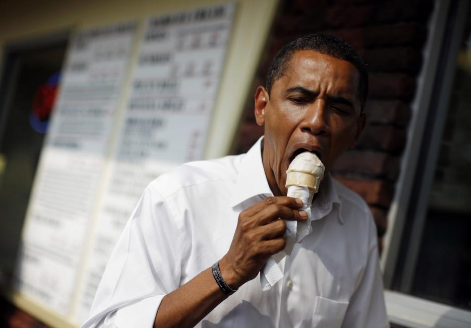 US Democratic presidential nominee Senator Barack Obama (D-IL) eats an ice cream cone during a campaign stop at Windmill Ice Cream Shop in Aliquippa, Pennsylvania