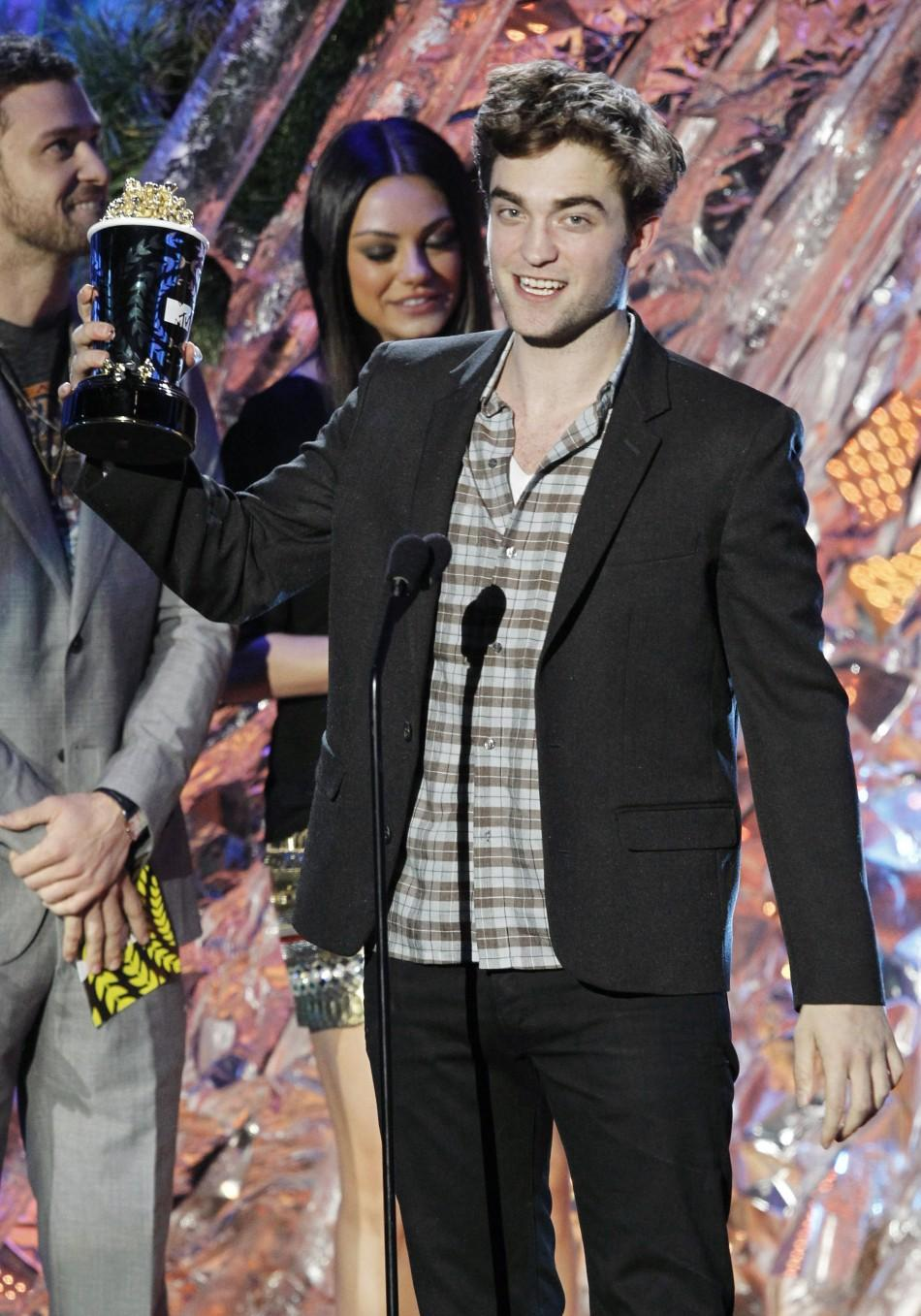 "Robert Pattinson accepts the award for best male actor for his role in ""The Twilight Saga: Eclipse"" at the 2011 MTV Movie Awards in Los Angeles, June 5, 2011."