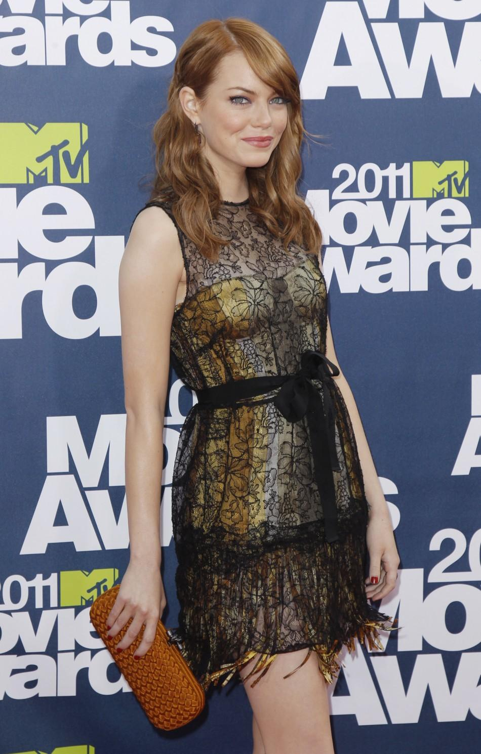 Actress Emma Stone arrives at the 2011 MTV Movie Awards in Los Angeles, June 5, 2011.