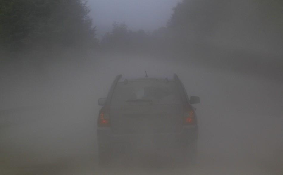 A car travels along a road covered with ashes near the erupting Puyehue volcano near Argentina's border.