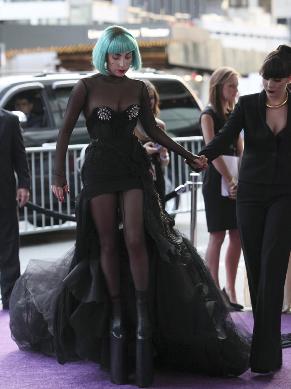 Gaga's latest look at the CFDA awards: spikey black dress, an aquamarine bob and sky high plaform boots