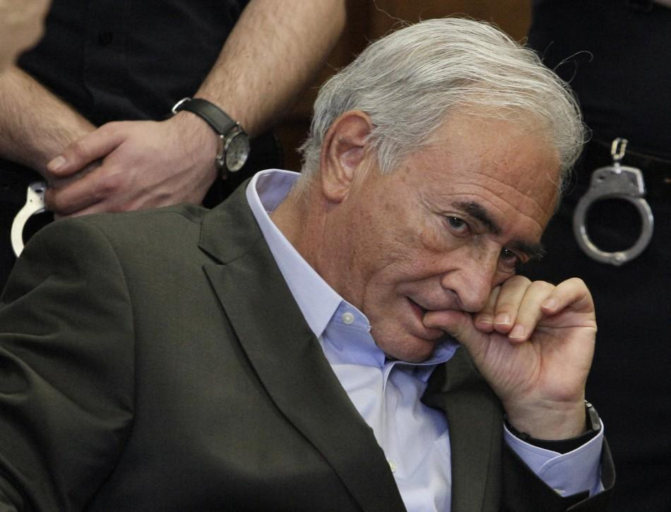 Former IMF chief Dominique Strauss-Kahn listens to his lawyer, William Taylor, inside of a New York State Supreme Courthouse during a bail hearing in New York May 19, 2011. Kahn was granted bail by a New York judge on Thursday, and the former IMF chief ha
