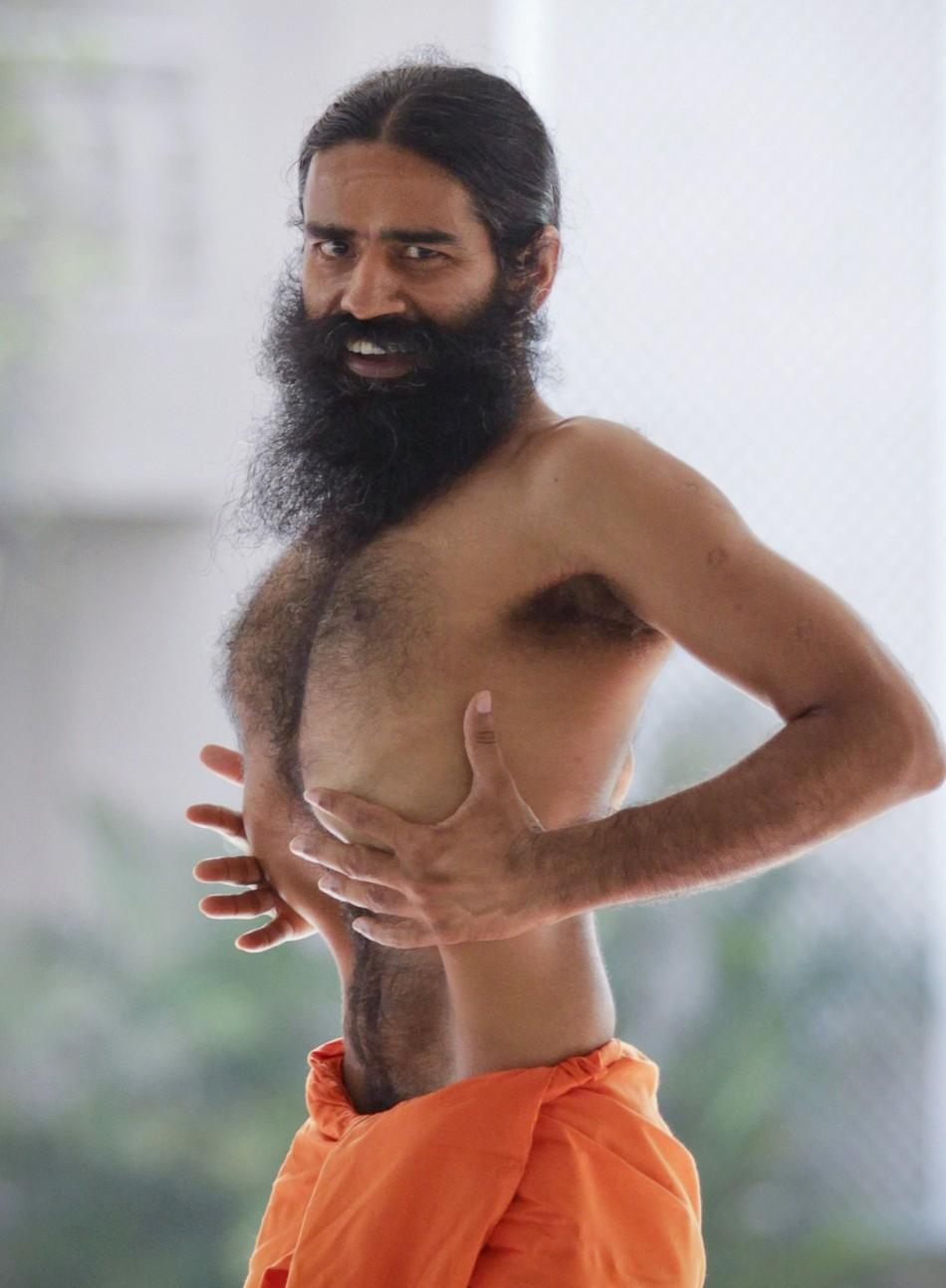 India's yoga guru Swami Ramdev performs yoga during his fast against corruption in the northern Indian town of Haridwar