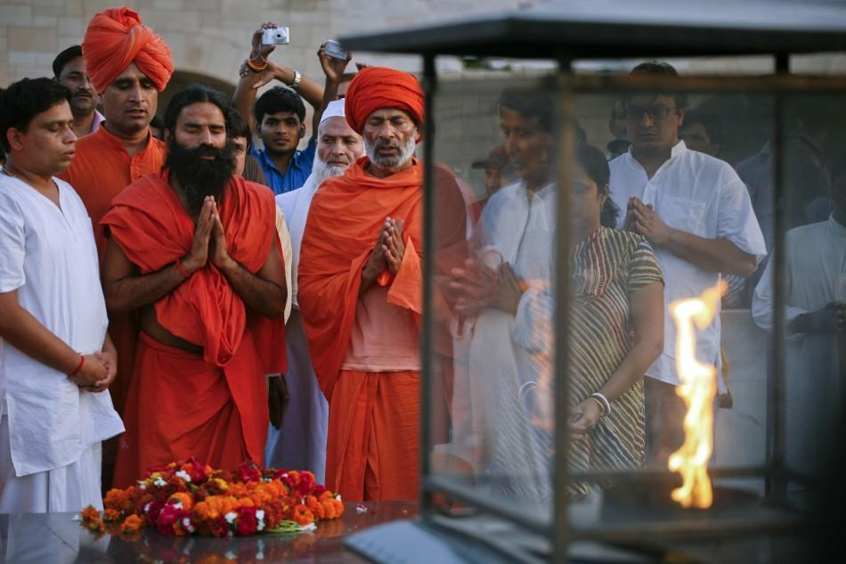 India's yoga guru Swami Ramdev offers prayers at the Mahatma Gandhi memorial at Rajghat in New Delhi