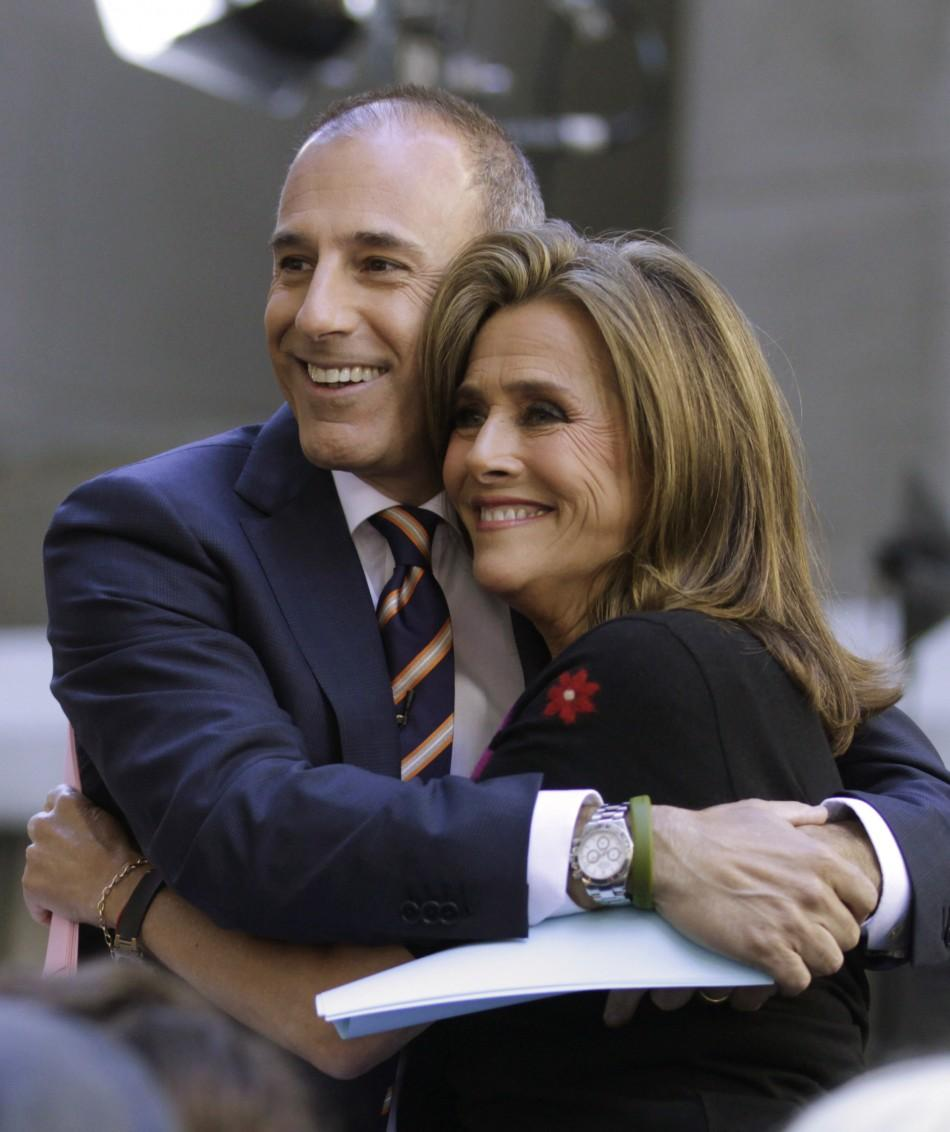 "Hosts of NBC's ""Today"" show Matt Lauer (L) and Meredith Vieira embrace during the show in New York June 3, 2011."