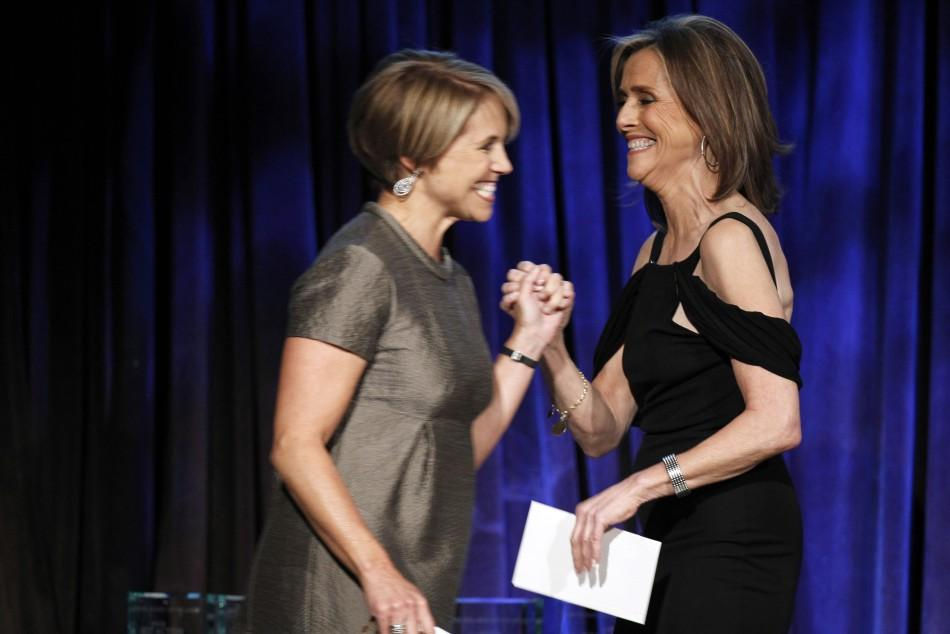 Host Meredith Vieira (R) greets journalist Katie Couric as she walks onstage to present an award during the National Board of Review Award ceremony in New York January 12, 2010.