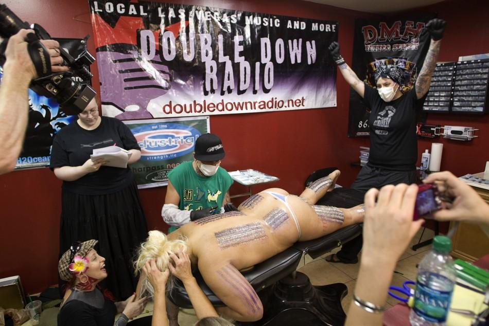 Body piercer Bill Robinson and sideshow performer Staysha Randall break the Guinness Book record in Las Vegas