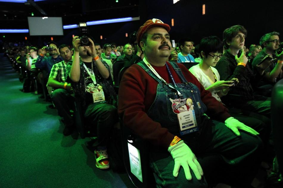 Guest Anthony Parisi is dressed like the videogame character Mario as he attends a Nintendo media briefing during the Electronic Entertainment Expo, or E3, in Los Angeles June 7, 2011.