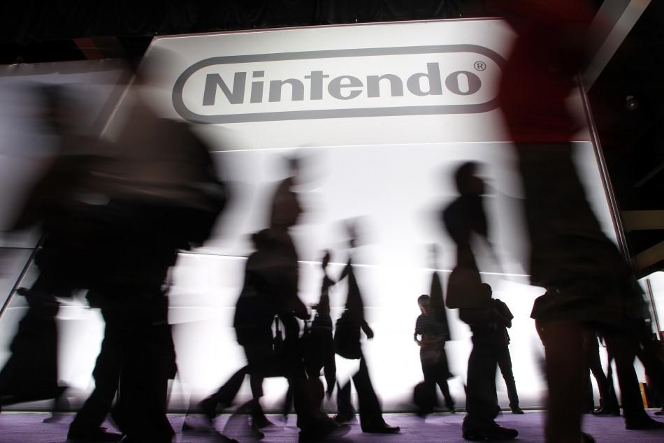 Attendees walk past the Nintendo of America Inc. booth during the Electronic Entertainment Expo or E3 in Los Angeles June 7, 2011.