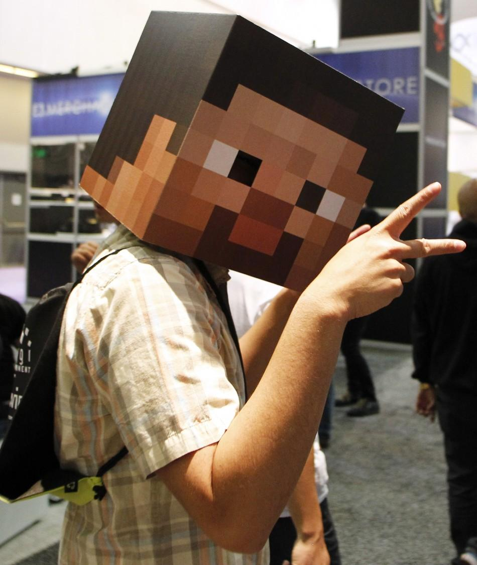 An attendee wears a video game cardboard face as he walks the floor of the the Electronic Entertainment Expo or E3 in Los Angeles June 7, 2011.