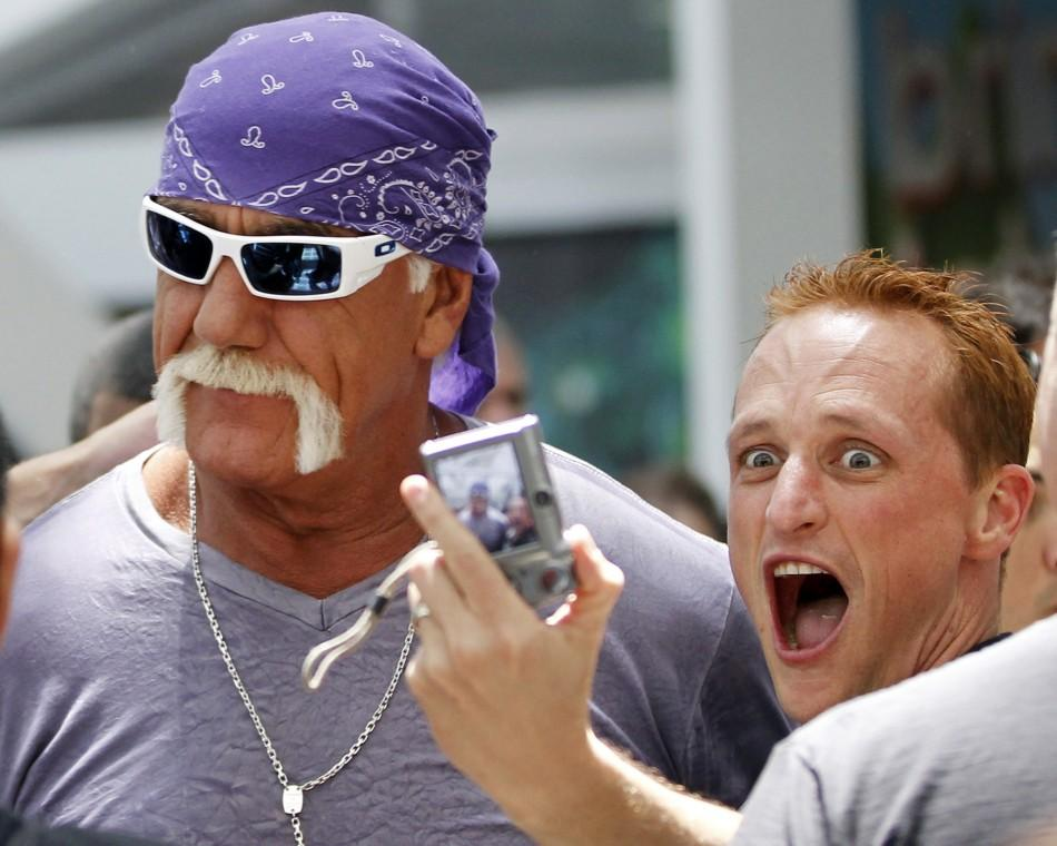 "A fan takes a photo with wrestler Hulk Hogan as he walks in the Los Angeles Convention Center while on site to promote Majesco Entertainment's ""Hulk Hogan's Main Event"" video game on Kinect for Xbox 360 during the Electronic Entertainm"