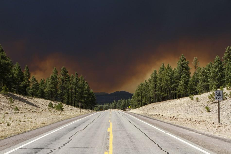 smoke fills the sky in Luna, New Mexico June 6, 2011