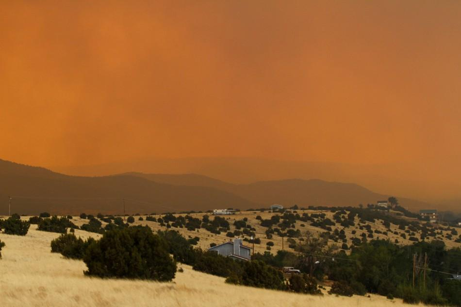 Smoke from the Wallow Wildfire rises over Round Valley High School Stadium in Springerville, Arizona June 7, 2011