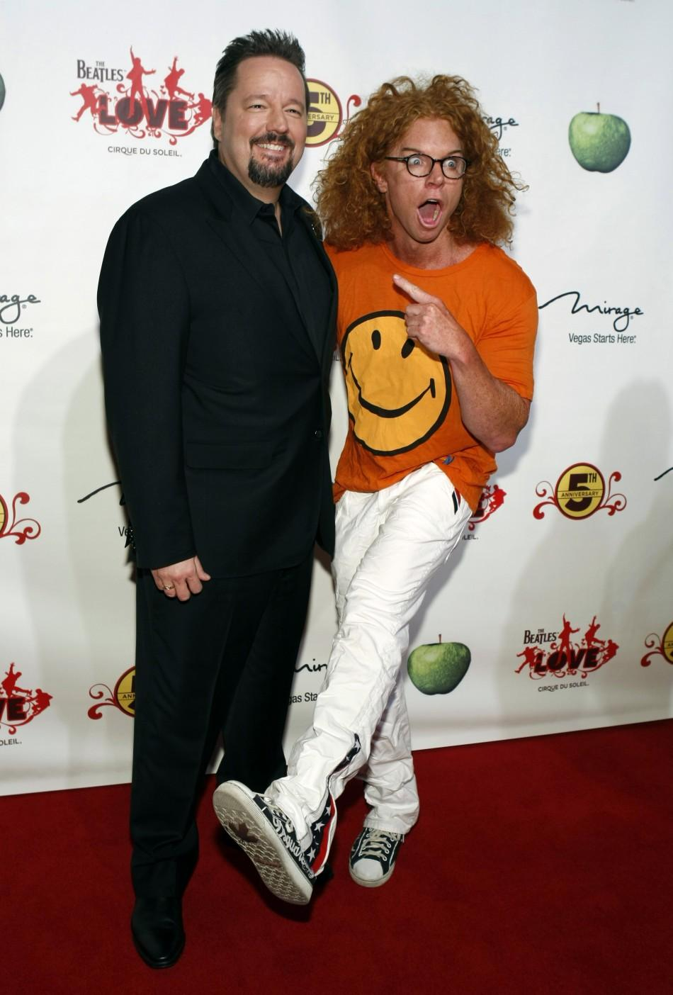 """Ventriloquist Terry Fator and comedian Carrot Top (R) arrive for the fifth anniversary celebration of """"The Beatles LOVE by Cirque du Soleil"""" show at the Mirage Hotel and Casino in Las Vegas, Nevada June 8, 2011."""