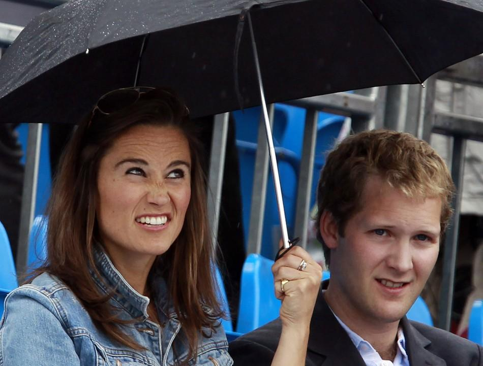 Pippa Middleton reacts before a rain break at the Queen's Club Championships in west London