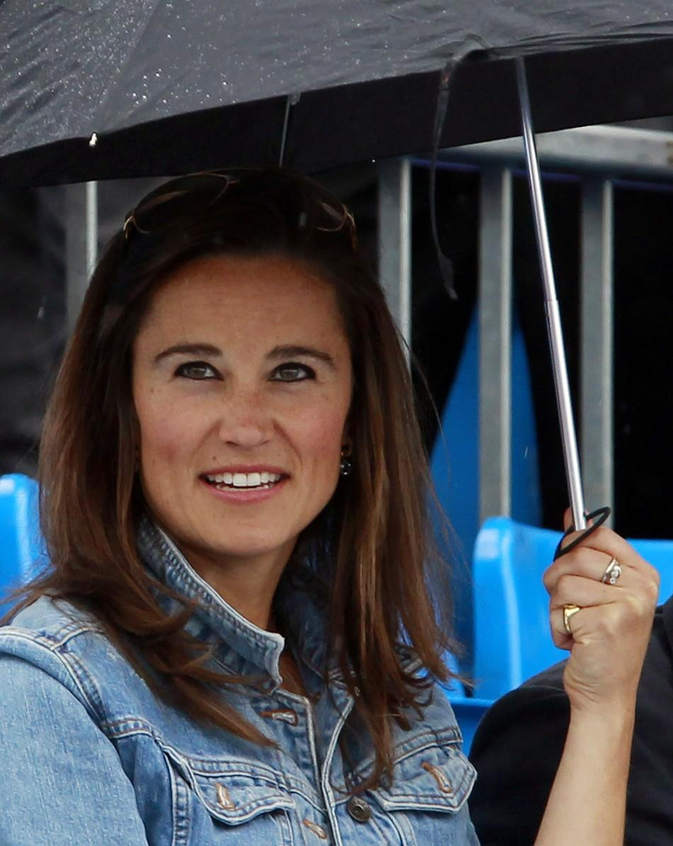 Pippa Middleton smiles before a rain break at the Queen's Club Championships in west London