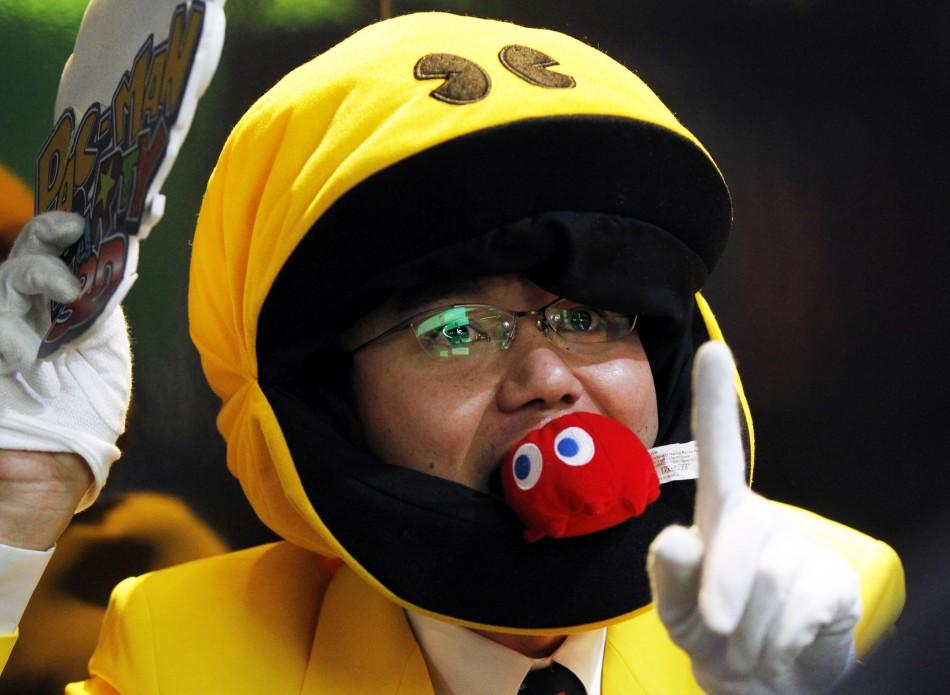 "A man dressed as the Pac-Man character from new video game ""Pac-Man Party 3D"" walks the floor during E3 in Los Angeles"