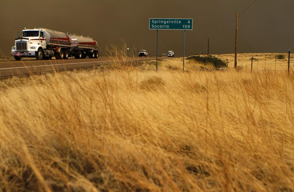 Motorist travel along U.S. Highway 60 as smoke from the Wallow Wildfire fills the sky in Springerville