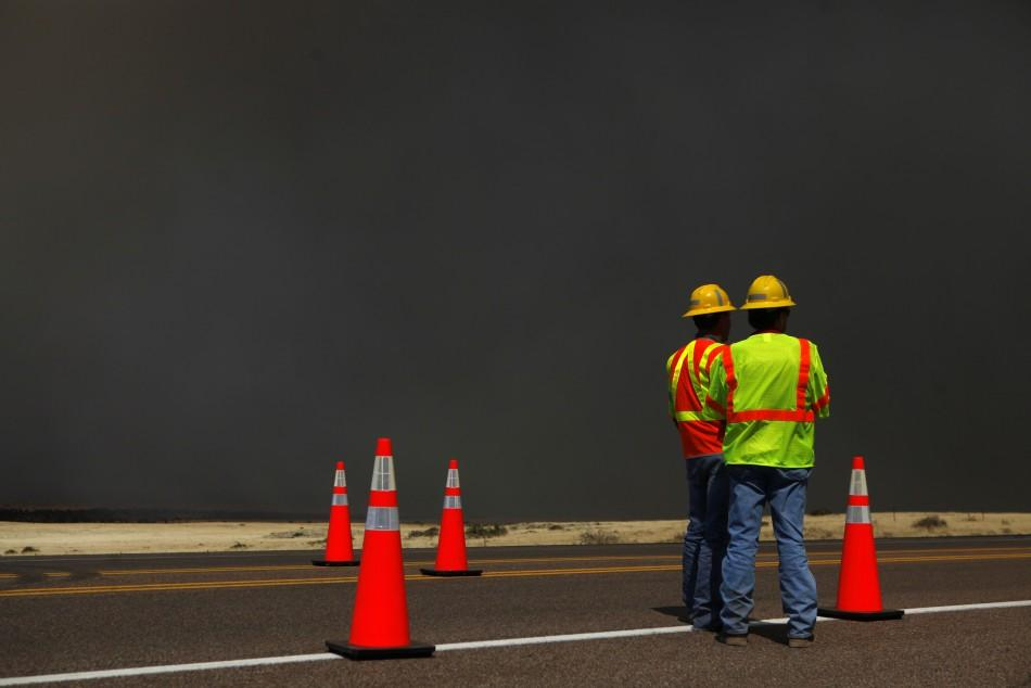 Arizona Department of Transportation workers prepare to close off a section of U.S. Highway 60 due to the Wallow Wildfire in Springerville