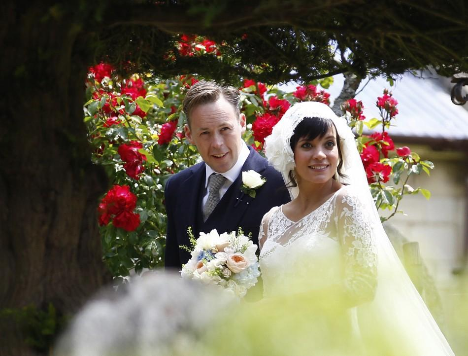 British singer Lily Allen smiles after marrying Sam Cooper as the couple leaves St James the Great Church in Cranham