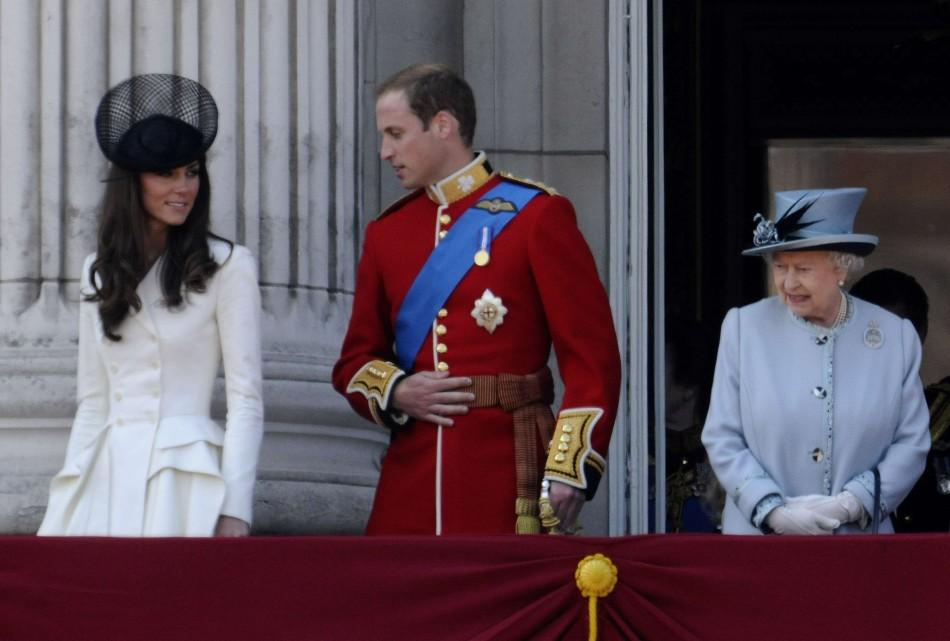 Britain's Queen Elizabeth, Prince William and his wife Catherine, Duchess of Cambridge (L) walk onto the balcony of Buckingham Palace after attending the Trooping the Colour ceremony in central London June 11, 2011. Trooping the Colour is a ceremony