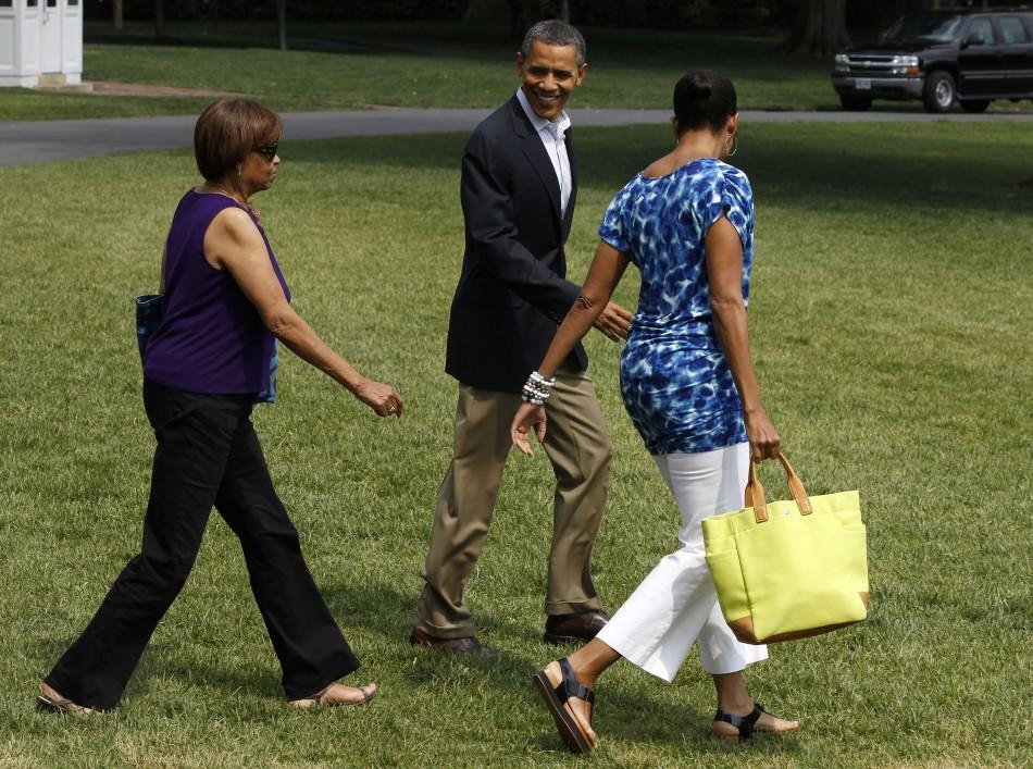 U.S. President Obama walks with his wife towards Marine One before departing for Camp David in Maryland